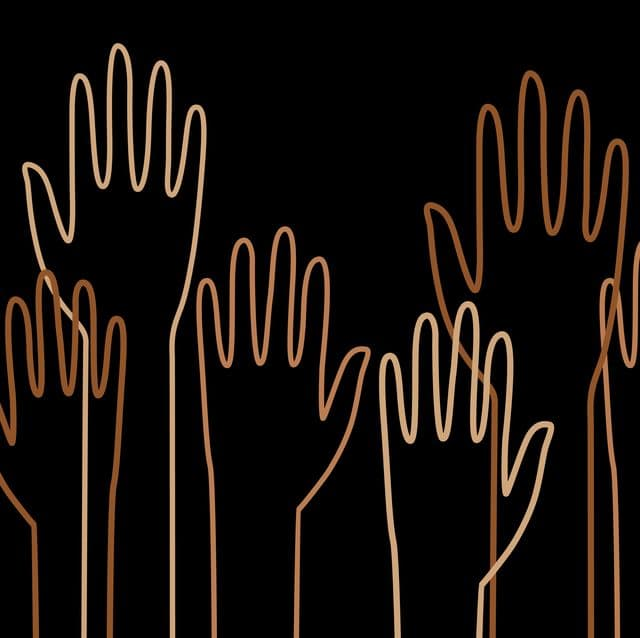 outlines of multiracial hands raised on black background